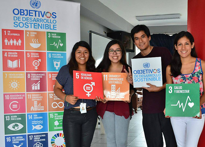 Young people holding the SDGs banners in Lima, Peru